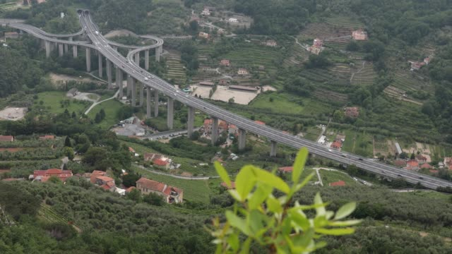 traffic moves along distant highway - liguria stock videos & royalty-free footage