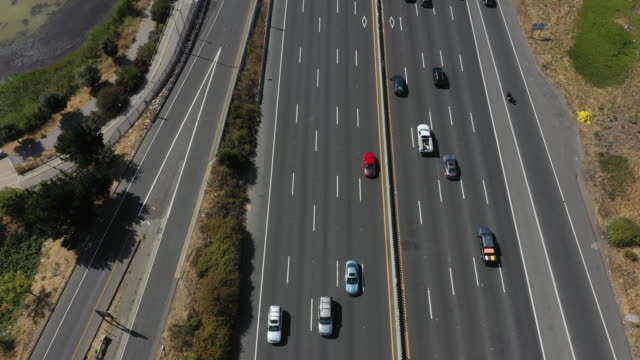 traffic moves along interstate 80 on july 25, 2019 in berkeley, california. the state of california and four of the largest automakers in the world -... - american interstate stock videos & royalty-free footage