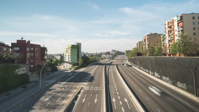 traffic moves along meridiana avenue one of the main entrances to the city during the coronavirus pandemic on april 25 2020 in barcelona spain... - portability stock videos & royalty-free footage