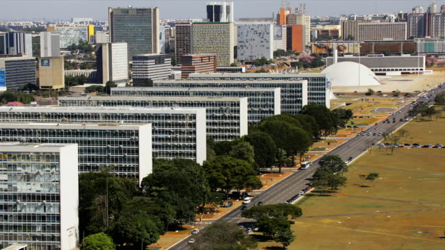 traffic moves along the ministries esplanade section of monumental axis in brasilia, brazil. - brasilia stock videos and b-roll footage