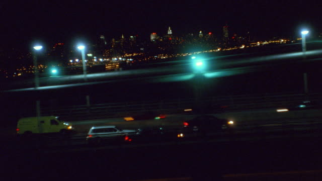 traffic moves along the top level of the george washington bridge in new york city. - dolly shot stock videos & royalty-free footage