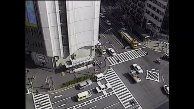 traffic moves along two busy streets running in parallel / shot at yokohama area on july 8 1987 - parallelo video stock e b–roll