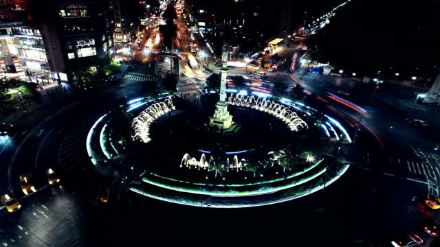 traffic moves around columbus circle in new york city at night. - columbus circle stock videos & royalty-free footage