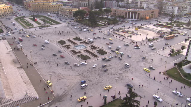 Traffic moves around Skanderberg Square in Tirana. Available in HD.