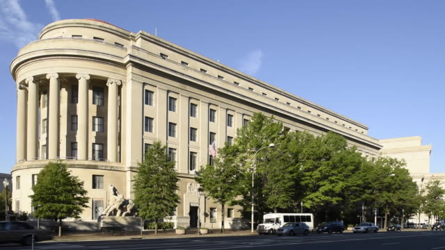 traffic moves by the federal trade commission building. - federal building stock videos & royalty-free footage