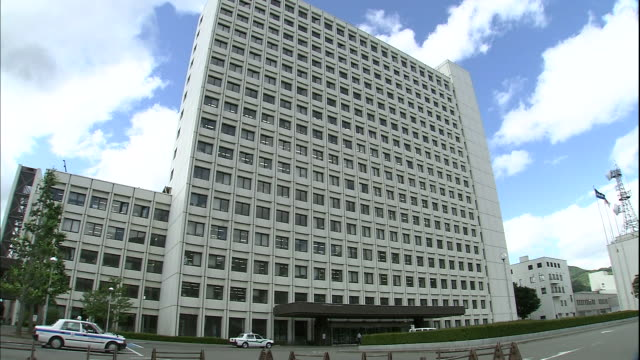 Traffic moves in front of the Yamagata Prefectural Government Office in Japan.