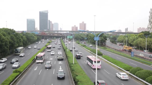 Traffic moves on a highway in downtown Shanghai China on Monday Sept 28 Traffic moves on a highway overpass in downtown Shanghai Traffic pass under...
