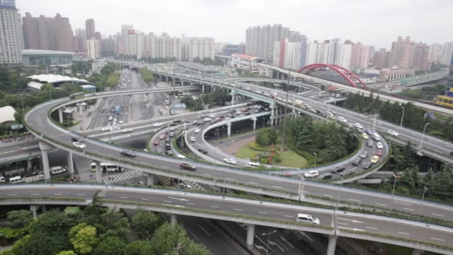 Traffic moves on a highway overpass in downtown Shanghai China on Monday Sept 28 2015