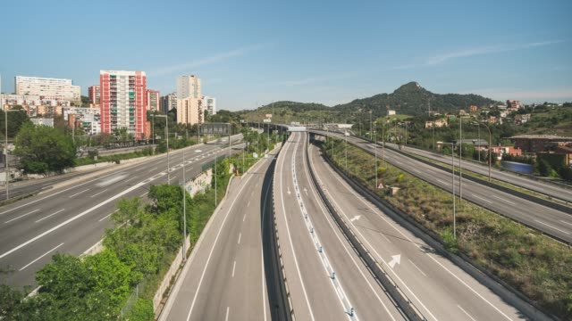 traffic moves on the c58 road one of the main entrances to the city during the coronavirus pandemic on april 25 2020 in barcelona spain nonessential... - portability stock videos & royalty-free footage
