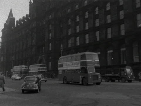 traffic moves past lime street railway station in liverpool 1964 - liverpool england stock videos & royalty-free footage