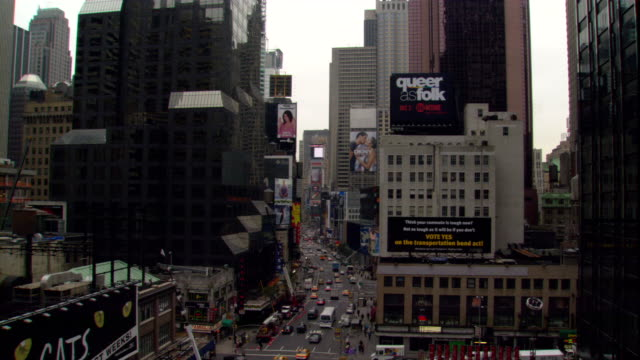 traffic moves past radio city music hall in new york city. - radio city music hall stock videos & royalty-free footage