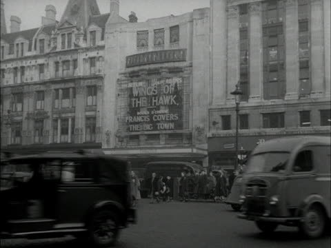 traffic moves past the corner of tottenham court road and across st giles circus. - tottenham court road stock videos & royalty-free footage