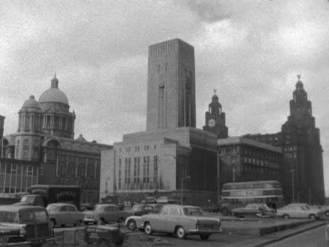 traffic moves past the liverpool port authority and the royal liver building. 1964. - merseyside stock videos & royalty-free footage