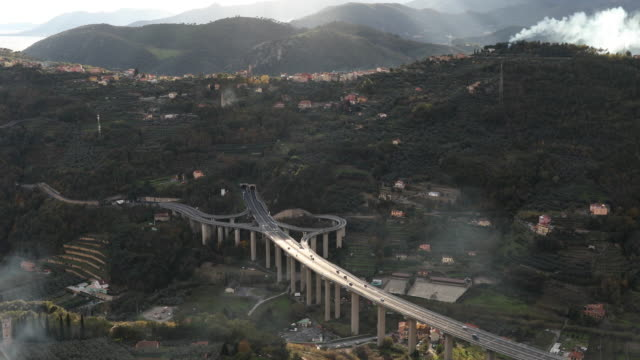 traffic moves quickly along twin highway, interchange - liguria stock videos & royalty-free footage
