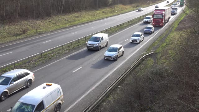vídeos de stock, filmes e b-roll de traffic moves slowly along the a303 in somerset on february 9, 2018 near ilminster, england. the uk government recently announced that it is to ban... - number 9