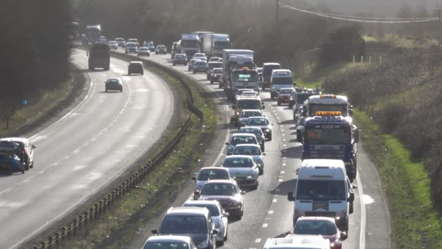 traffic moves slowly along the a303 in somerset on february 9, 2018 near ilminster, england. the uk government recently announced that it is to ban... - traffic jam stock videos & royalty-free footage