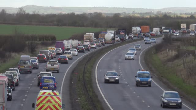 traffic moves slowly along the a303 in somerset on february 9, 2018 near ilminster, england. the uk government recently announced that it is to ban... - somerset england stock videos & royalty-free footage