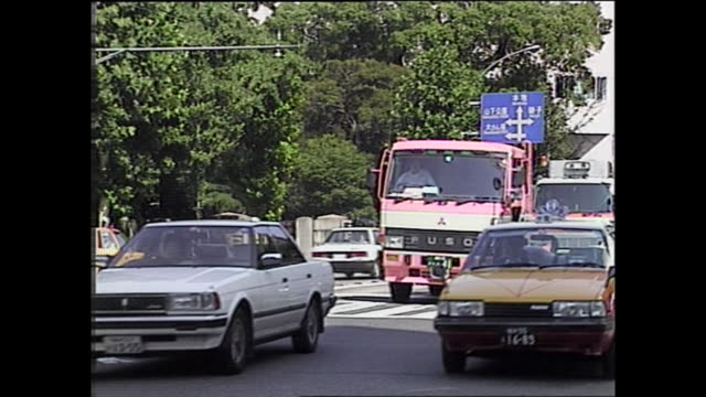 Traffic moves slowly on a congested street / Shot at Yokohama area on July 8 1987