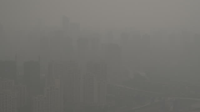 traffic moves slowly through a heavy smog - smog stock videos & royalty-free footage