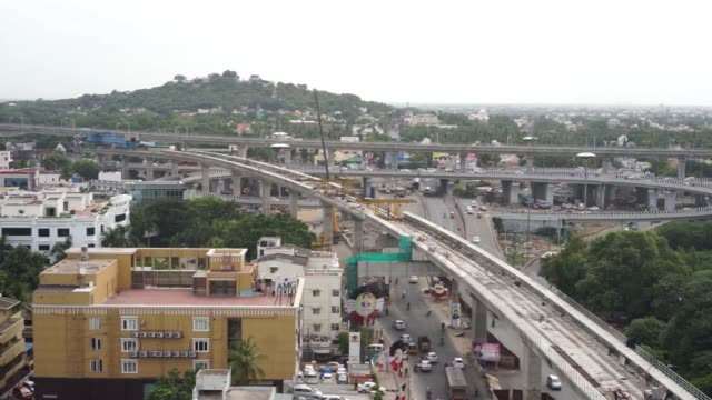 traffic moves smoothly along the construction site of the chennai metro project in chennai laborers work on an elevated track under construction as... - chennai stock videos & royalty-free footage
