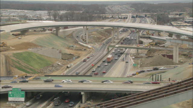 Traffic moves through a busy highway interchange.