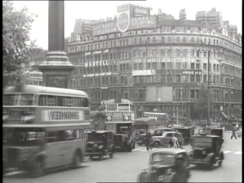 traffic moves through a busy street in piccadilly circus and trafalgar square. - anno 1947 video stock e b–roll
