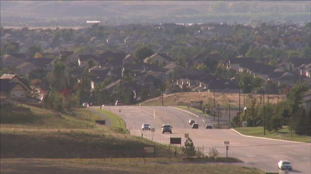 traffic moves through a denver suburb. - colorado stock videos & royalty-free footage