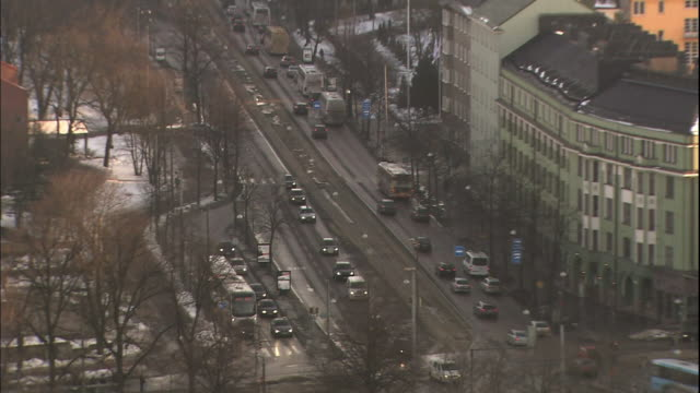 Traffic moves through a street in the city of Helsinki, Finland.