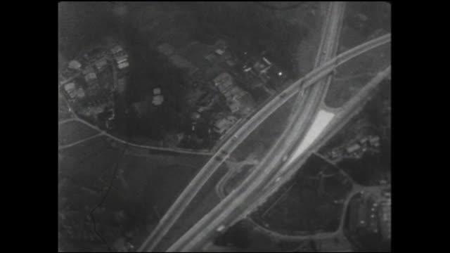 vídeos de stock e filmes b-roll de traffic moves through an interchange on the yokohama shindo. - formato letterbox