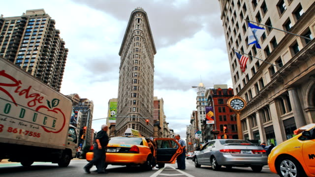 traffic moves through an intersection in new york city. - hair straighteners stock videos and b-roll footage