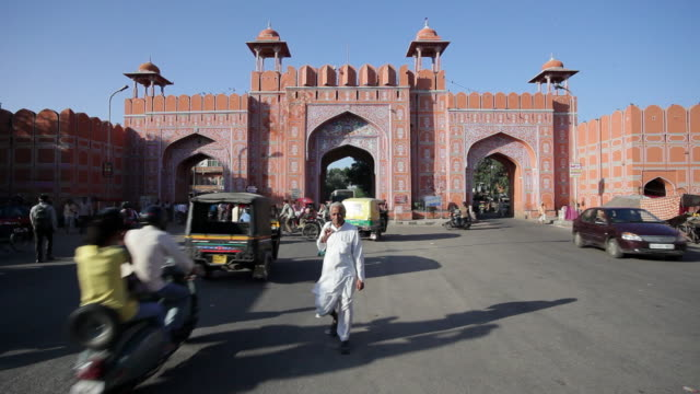 Traffic moves through an opening in the Pink Gate.