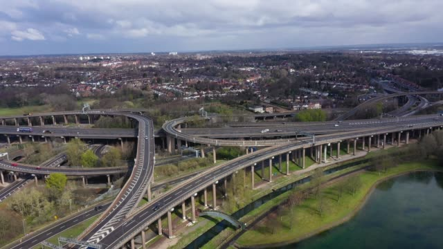 vídeos de stock e filmes b-roll de traffic moves through gravelly hill interchange junction 6 of the m6 motorway where it meets the a38 aston expressway commonly known as spaghetti... - road junction
