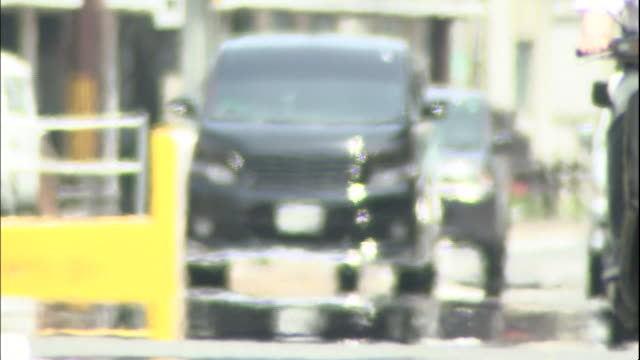 Traffic moves through heat waves on the hot pavement.