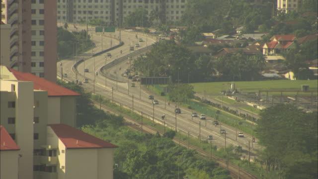 traffic moves through kuala lumpur on a busy thoroughfare. - kuala lumpur video stock e b–roll