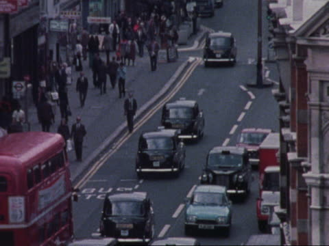Traffic moves through Oxford Street in London.