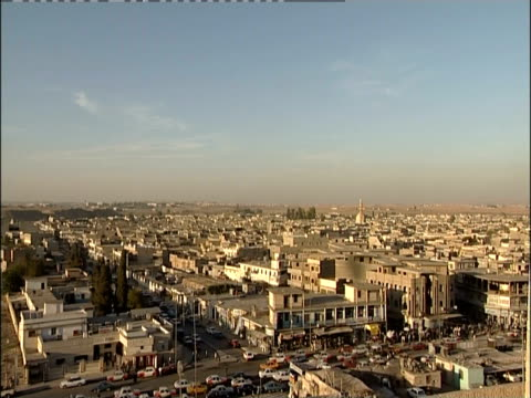 traffic moves through the crowded city of mosul, iraq. - iraq stock videos & royalty-free footage