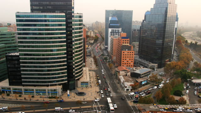 traffic moves through the intersection of avenida el bosque norte and avenida vitacura in santiago, chile. - avenida stock videos & royalty-free footage