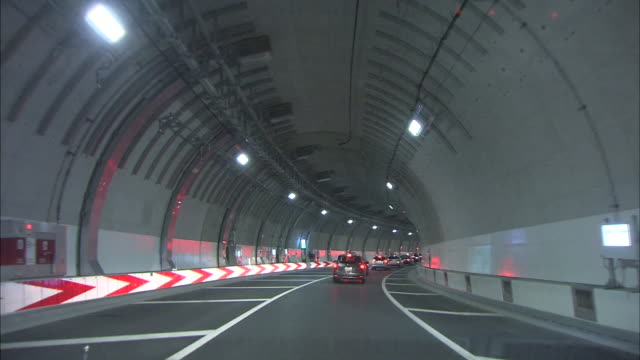 traffic moves through the tunnel of ohashi junction on the tokyo metropolitan expressway. - western script stock videos & royalty-free footage