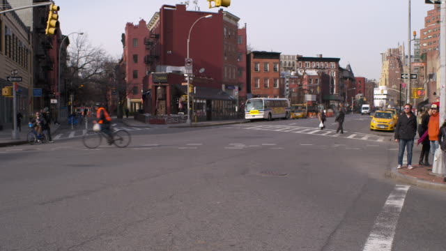traffic moving along 6th avenue in greenwich village in manhattan - greenwich village stock videos & royalty-free footage