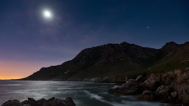 T/L traffic moving along mountain pass at night, Kogel Bay, South Africa
