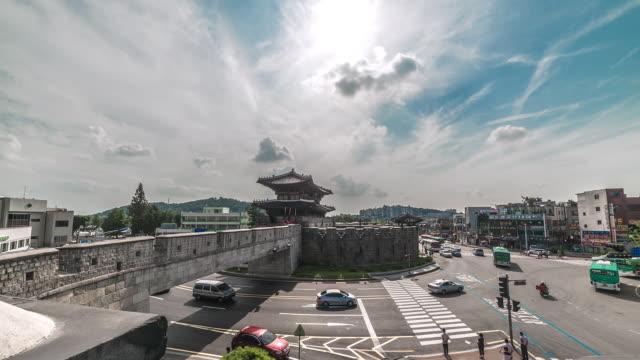 ws t/l traffic moving at janganmun gate in suwon hwaseong castle (unesco world heritage site) / suwon, gyeonggi do, south korea - hwaseong palace stock videos and b-roll footage