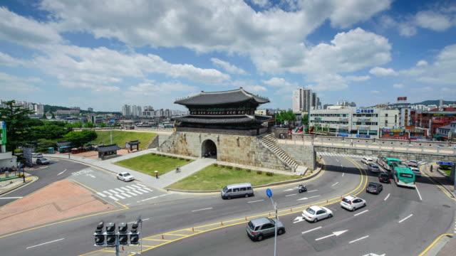 ms t/l traffic moving at janganmun gate in suwon (unesco world heritage site) / suwon, gyeonggi-do, south korea - suwon stock videos and b-roll footage