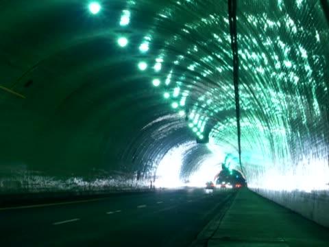 vídeos de stock, filmes e b-roll de traffic moving in a tunnel - tunnel