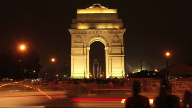 Traffic moving in front of India Gate, Delhi, India