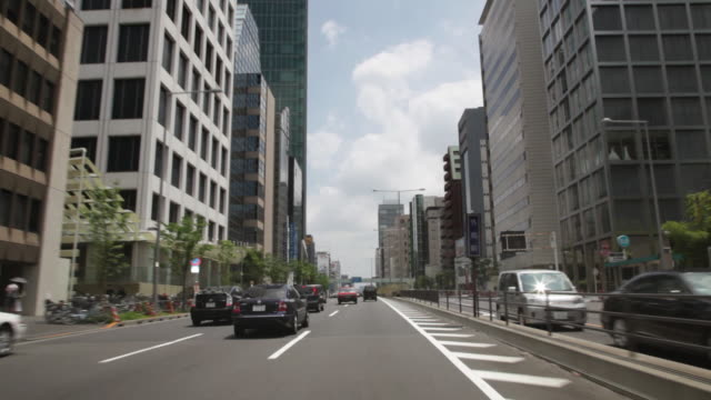 MS POV Traffic moving in neighborhood of Aoyama / Tokyo, Japan