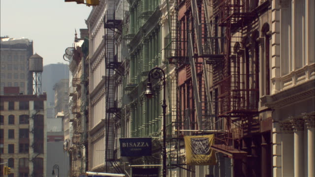 Traffic moving on a narrow street in the SoHo district of New York City.