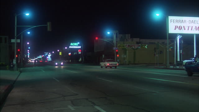 ms pan traffic moving on la brea and third streets - 1980 stock videos & royalty-free footage