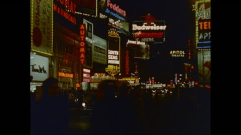 ws traffic moving on broadway with illuminated commercial signs at night / new york city, new york state, united states - capital letter stock videos & royalty-free footage
