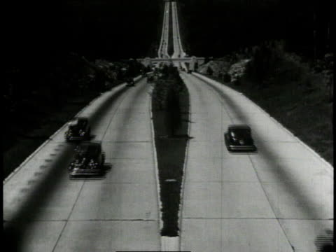1940 ws traffic moving on dual lane highway / united states - 1940 stock videos and b-roll footage