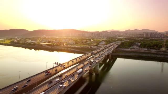 Traffic moving on Gangdong Bridge at sunset